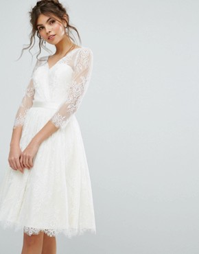 photo Lace Overlay Dress by Chi Chi London, color Ivory - Image 1