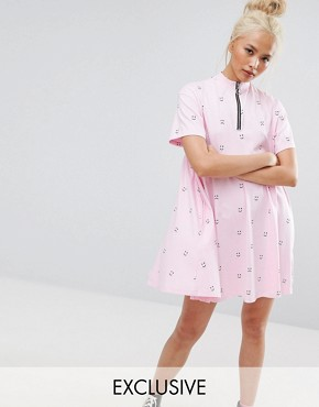 photo Short Sleeve Smock Dress in Faces Print with Zip by Lazy Oaf, color Pink - Image 1