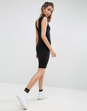 photo Mini Dress with Low Back and Shoulder Pads by ASOS, color Black - Image 1