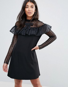 photo Long Sleeve Shift Dress with Mesh Polka Dot Sleeves and Frill Detail by Amy Lynn Occasion, color Black - Image 1