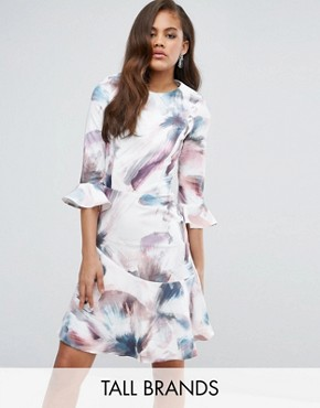 photo All Over Printed Fluted Skater Dress by Little Mistress Tall, color Multi - Image 1