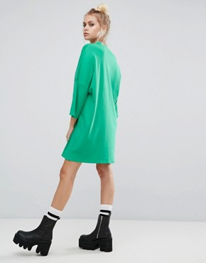 photo Oversized T-Shirt Dress with Toxic Slogan by The Ragged Priest, color Green - Image 2
