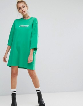photo Oversized T-Shirt Dress with Toxic Slogan by The Ragged Priest, color Green - Image 1