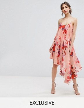 photo Asymmetric Cami Dress in Oversize Floral Print by Hope & Ivy, color Red Based Floral - Image 1