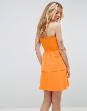 photo Bandeau Shirred Mini Sundress with Peplum Hem by ASOS, color Bright Orange - Image 2