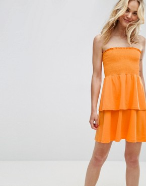 photo Bandeau Shirred Mini Sundress with Peplum Hem by ASOS, color Bright Orange - Image 1