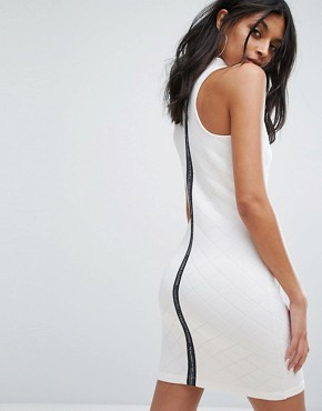 photo High Neck Quilted Dress in White by Adidas Originals, color White - Image 1