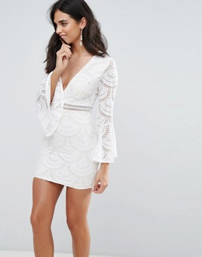 photo Flute Sleeve Lace Mini Dress by Love & Other Things, color White - Image 1
