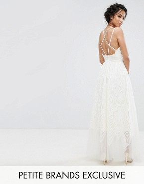 photo Lace Maxi Dress with Cami Cross Back Strap Detail by Chi Chi London Petite Premium, color Ivory - Image 1