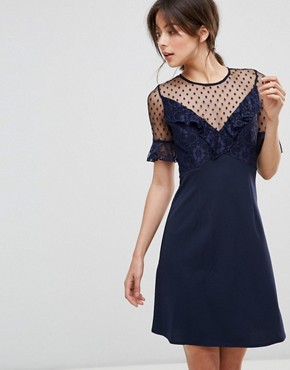photo A-Line Mini Dress with Lace Frill & Fluted Sleeve by Elise Ryan, color Navy - Image 1