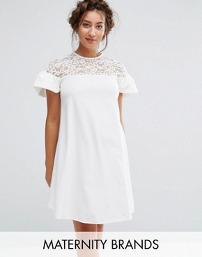photo Lace Ruffle Sleeve Smock Dress by Queen Bee Maternity, color White - Image 1