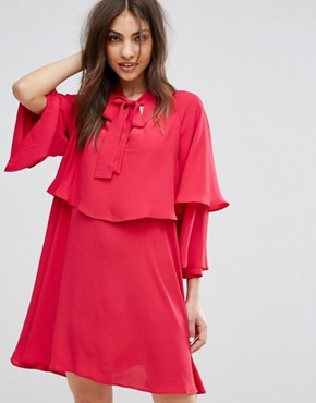photo Flute Sleeve Tie Front Smock Dress by Mango, color Pink - Image 1