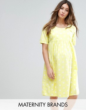 photo Spotty Short Sleeve Skater Dress by Mamalicious, color Yellow - Image 1