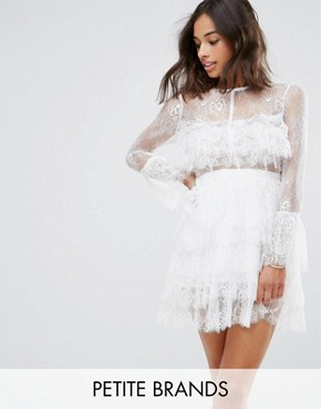 photo Lace Ruffle Mini Dress with Sheer Sleeve Detail by True Decadence Petite Premium, color White - Image 1