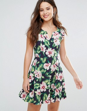 photo Gael Dress in Floral Print by Louche, color Navy - Image 1