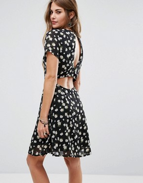photo Daisy Print Open Back Dress by Rage, color Black - Image 1