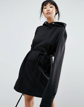 photo Longline Hoodie Dress with Cut Out Back Detail by House of Sunny, color Black - Image 2