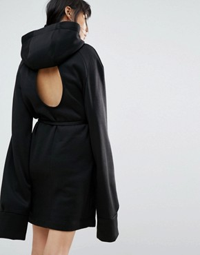 photo Longline Hoodie Dress with Cut Out Back Detail by House of Sunny, color Black - Image 1