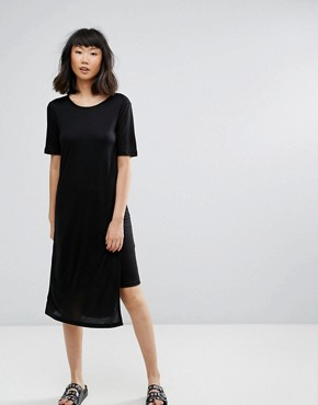 photo Asymmetric T-Shirt Dress by Moss Copenhagen, color Black - Image 1