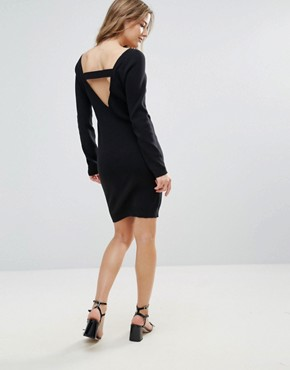 photo Jumper Dress with Back Strap Detail by The English Factory, color Black - Image 1