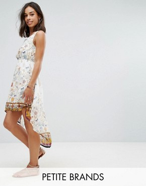 photo Dip Hem Dress in Meadow Print by Yumi Petite, color Cream - Image 1
