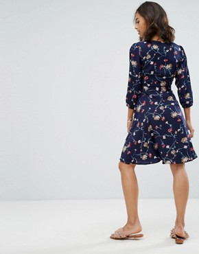 photo Wrap Front Dress in Floral Print by Yumi Petite, color Navy - Image 2