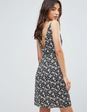 photo Floral Printed Cross Back Wrap Dress by QED London, color Black - Image 1