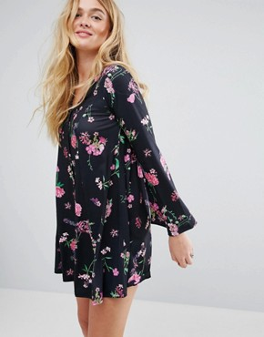 photo Button Through Mini Swing Dress with Trumpet Sleeve in Floral Print by ASOS, color Multi - Image 1