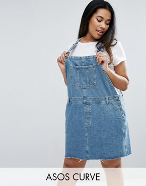 photo Denim Dungaree Dress in Midwash Blue by ASOS CURVE, color Blue - Image 1