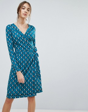 photo Geometric Daisy Print Wrap Dress by Uttam Boutique, color Teal - Image 1