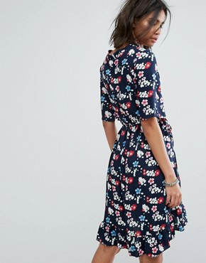 photo Vintage Wrap Front Mini Dress in Floral by Milk It, color Navy - Image 2