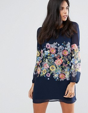 photo Botanical Print Long Sleeve Shift Dress by Yumi, color Navy - Image 1