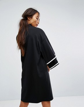 photo Ruffle Sleeve Zip Up Sporty Dress by Monki, color Black - Image 2
