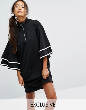 photo Ruffle Sleeve Zip Up Sporty Dress by Monki, color Black - Image 1