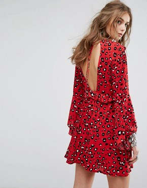 photo Smock Dress with Ruffle Trims and Ribbon Ties in Leopard by Kiss The Sky, color Red - Image 2