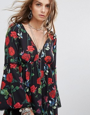 photo Swing Dress with Flared Sleeves and Tie Back in Floral Print by Kiss The Sky, color Black - Image 3