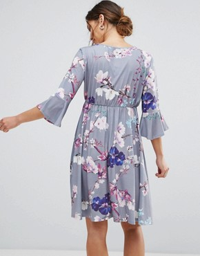 photo Flared Sleeve Wrap Front Skater Dress in Floral by Bluebelle Maternity, color Grey Floral - Image 2