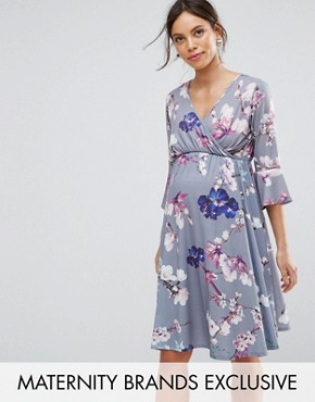 photo Flared Sleeve Wrap Front Skater Dress in Floral by Bluebelle Maternity, color Grey Floral - Image 1