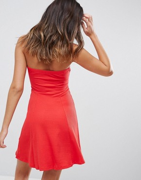 photo Mini Twist Front Bandeau Skater Dress by ASOS, color Red - Image 2