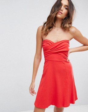 photo Mini Twist Front Bandeau Skater Dress by ASOS, color Red - Image 1