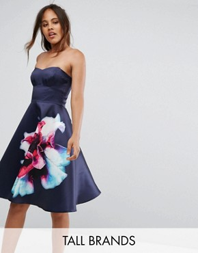 photo Bandeau Skater Dress with Placement Floral Print by City Goddess Tall, color Navy - Image 1