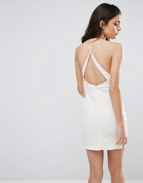photo Hands Down Lace Dress with Cut Out Back by WYLDR, color Ivory - Image 1