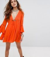 photo Romeo Flared Sleeve Dress by Free People, color Peach - Image 1