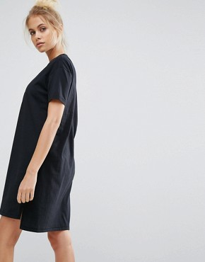photo Varsity Overlapped Logo Tee Dress in Black by Converse, color Black - Image 2