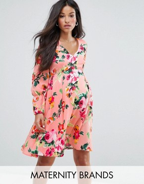 photo Floral Tea Dress with Bow Sleeve Detail by Queen Bee Maternity, color Pink - Image 1
