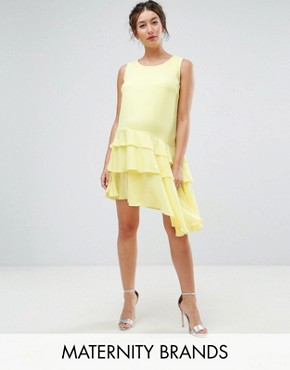 photo Asymmetric Ruffle Hem Mini Dress by Queen Bee Maternity, color Yellow - Image 1