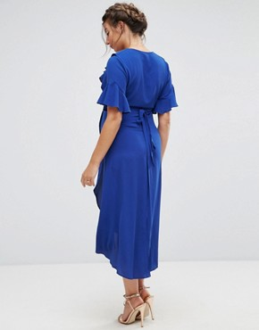photo Wrap Dress with Asymmetric Hem by Queen Bee Maternity, color Blue - Image 2