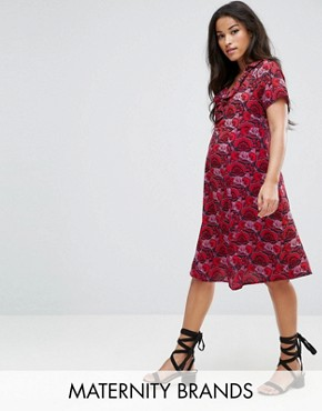 photo Bold Printed Dress by Mamalicious, color Tomato Puree - Image 1