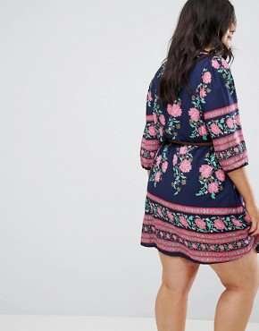 photo Belted Dress with 3/4 Sleeves in Border Floral Print by Yumi Plus, color Navy - Image 2