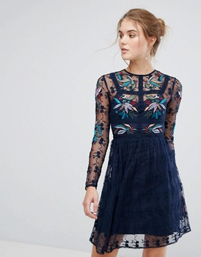 photo Floral Embroidered Skater Mini Dress with Lace Trim by Frock and Frill, color Navy - Image 1